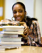 student with library books